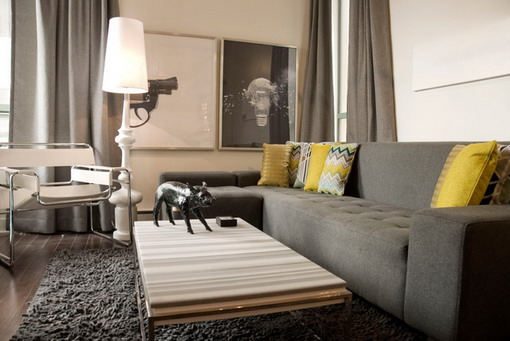 Let S All Admire This Dark Grey Sofa Paired Perfectly With Yellow Accents